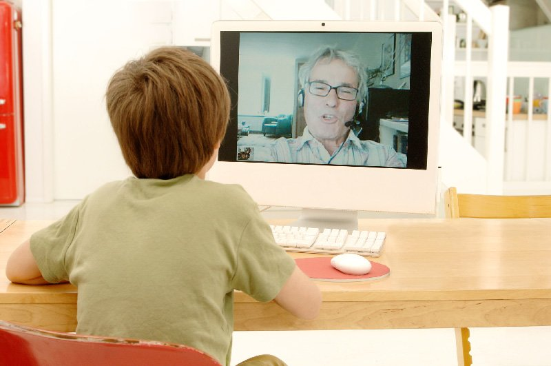 boy video chatting with man